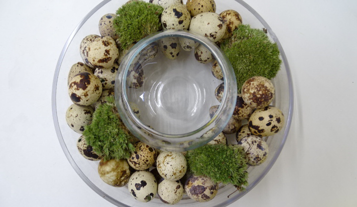 To add texture to the base, scatter cushion moss around the vase or an alternative ingredient of your choice.