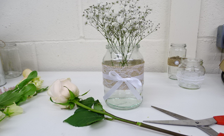 Next, add the rose to the arrangement. Simply, cut the stem to size and place into the jam jar. TOP TIP: The flowers will work out half of the overall height of the finished arrangement.