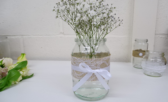 Starting with the Gypsophila; here we are using just 1 stem in the jam jar. Divide the stem into equal pieces where they naturally branch and bunch together in the jam jar. This acts as a frame for the arrangement to guide the other flowers.