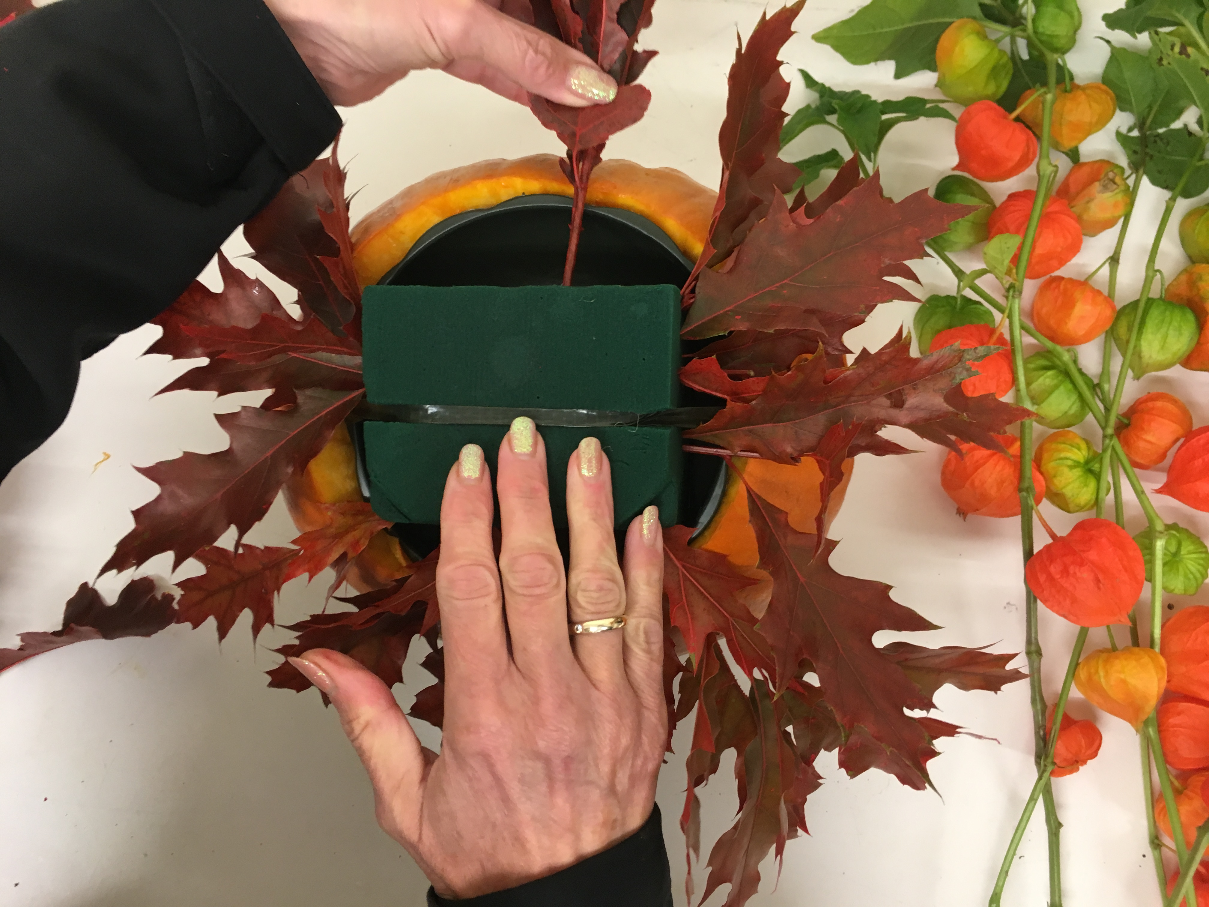 Using the Oak Leaves or your chosen foliage, create a collar around the base of the dish