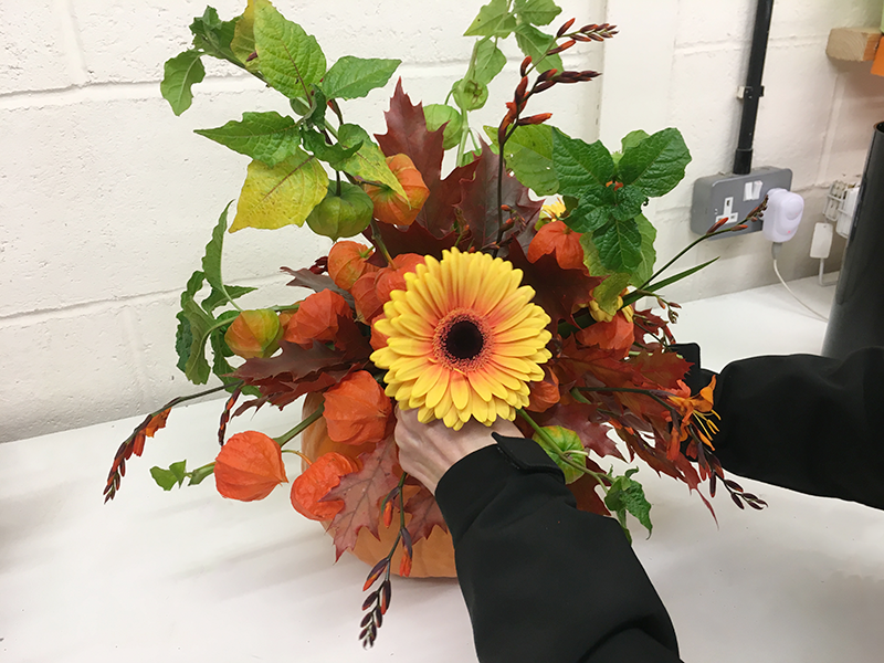 Now you will need to add the focal flowers. Here, we are using Gerbera Acapulco, a two toned yellow Gerbera.