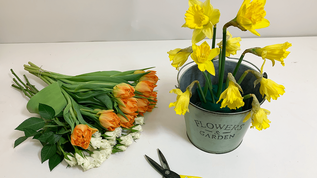 Start by adding the Daffodils into the arrangement. If the stems are too soft/weak to add into the floral foam, you can support the stem by adding a plant stick into the stem and inserting into the floral foam.