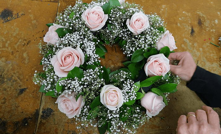 The final step is to add the Gypsophila in the gaps on the wreath. Cut the Gypsophila into smaller stems and place into the floral foam - the type and the amount of gypsophila added to the wreath will be based on your personal preferences.