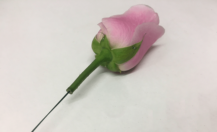 ... and here, we have the final result. You will now need to seal the rose with parafilm tape from underneath the head of the rose on the natural stem all the way down to where the wire finishes.
